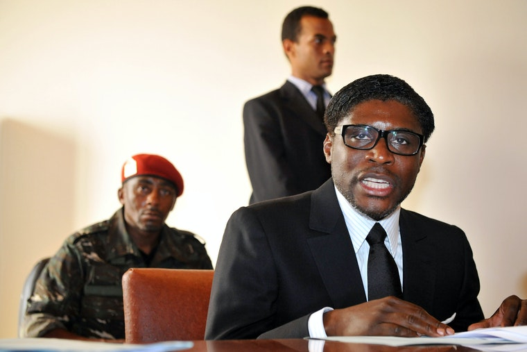 Teodoro Nguema Obiang Mangue at a table