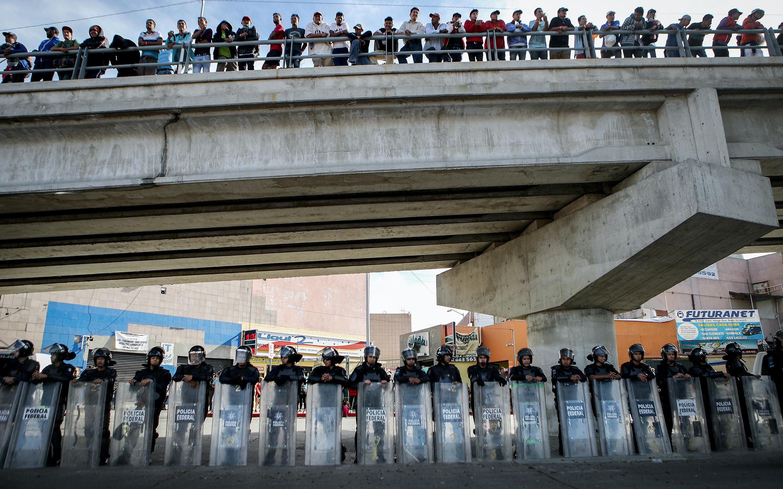 Police under a bridge in Tijuana, Mexico