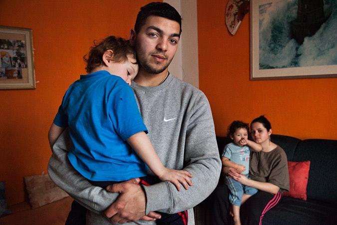 Julias Mikas holding son