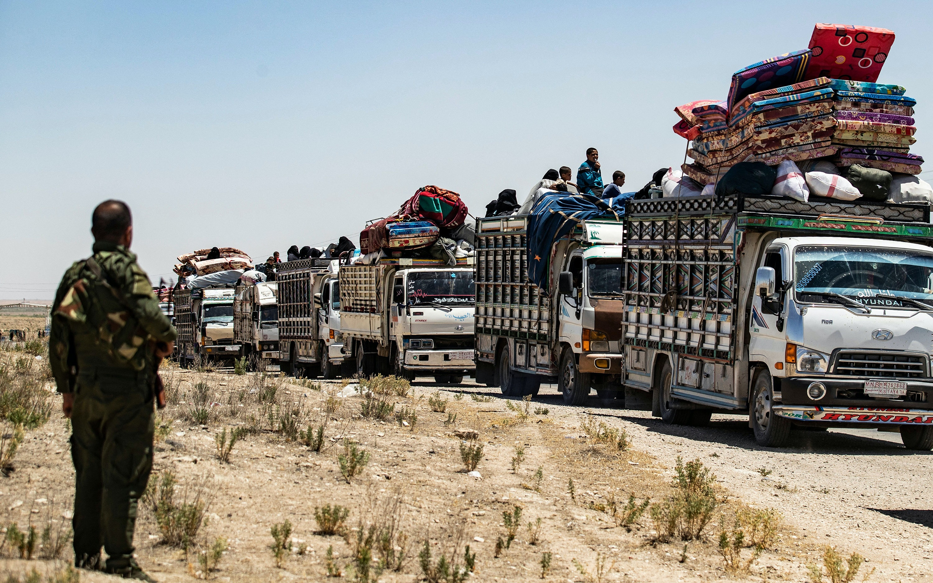 People are released from camp in northeastern Syria.