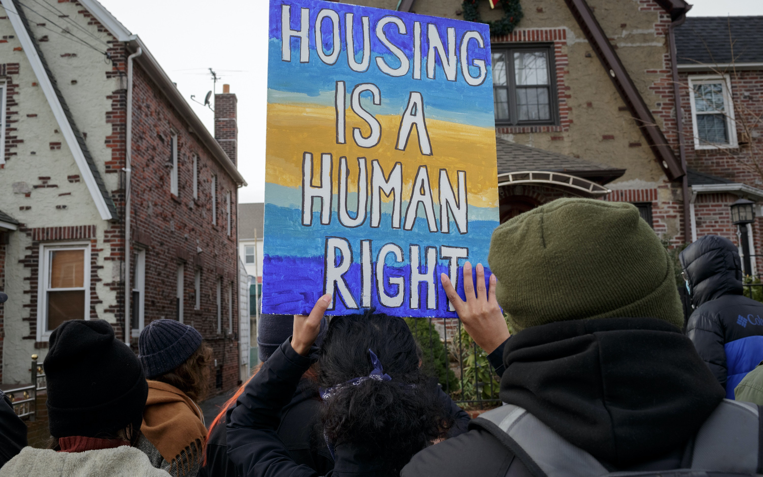 People gather for a protest for housing security in New York City.