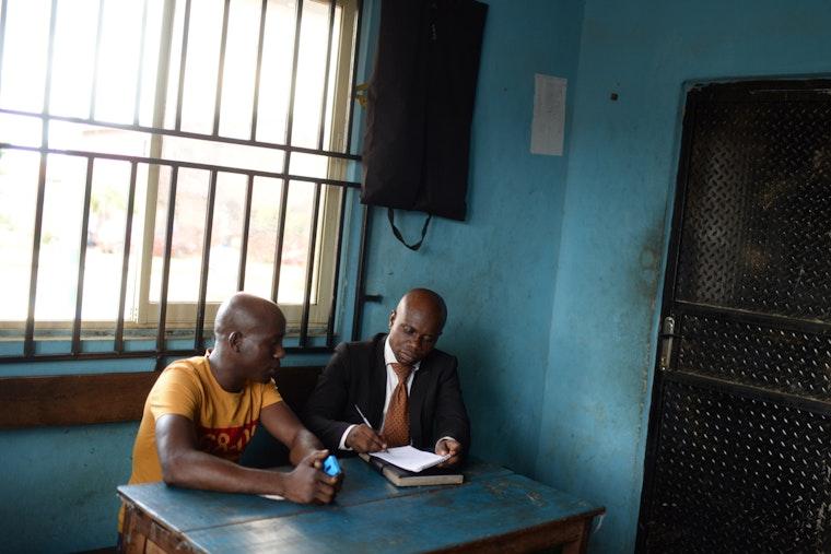 Two men inside a jail